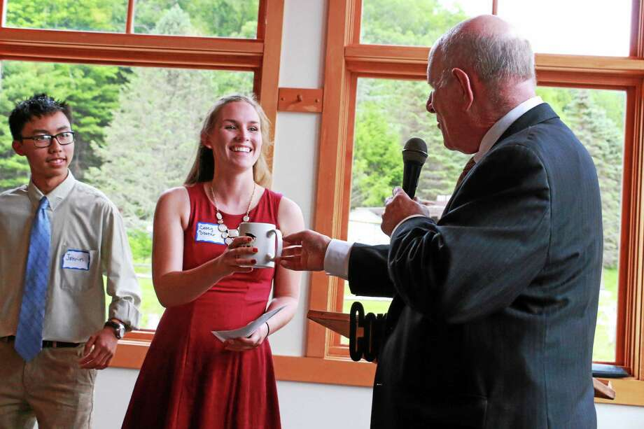 In addition to one $5,000 scholarship each, the New Hartford business council presented Casey Stotler and Jakrin Lanphouthachoul with a special coffee mug. Photo: John Fitts — The Register Citizen