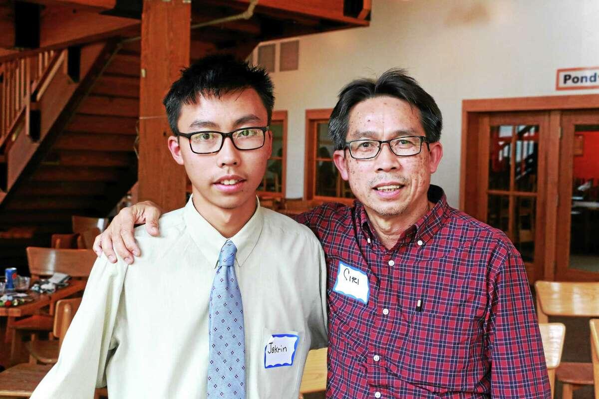 Scholarship winner Jakrin Lanphouthachoul and his dad, Siri.