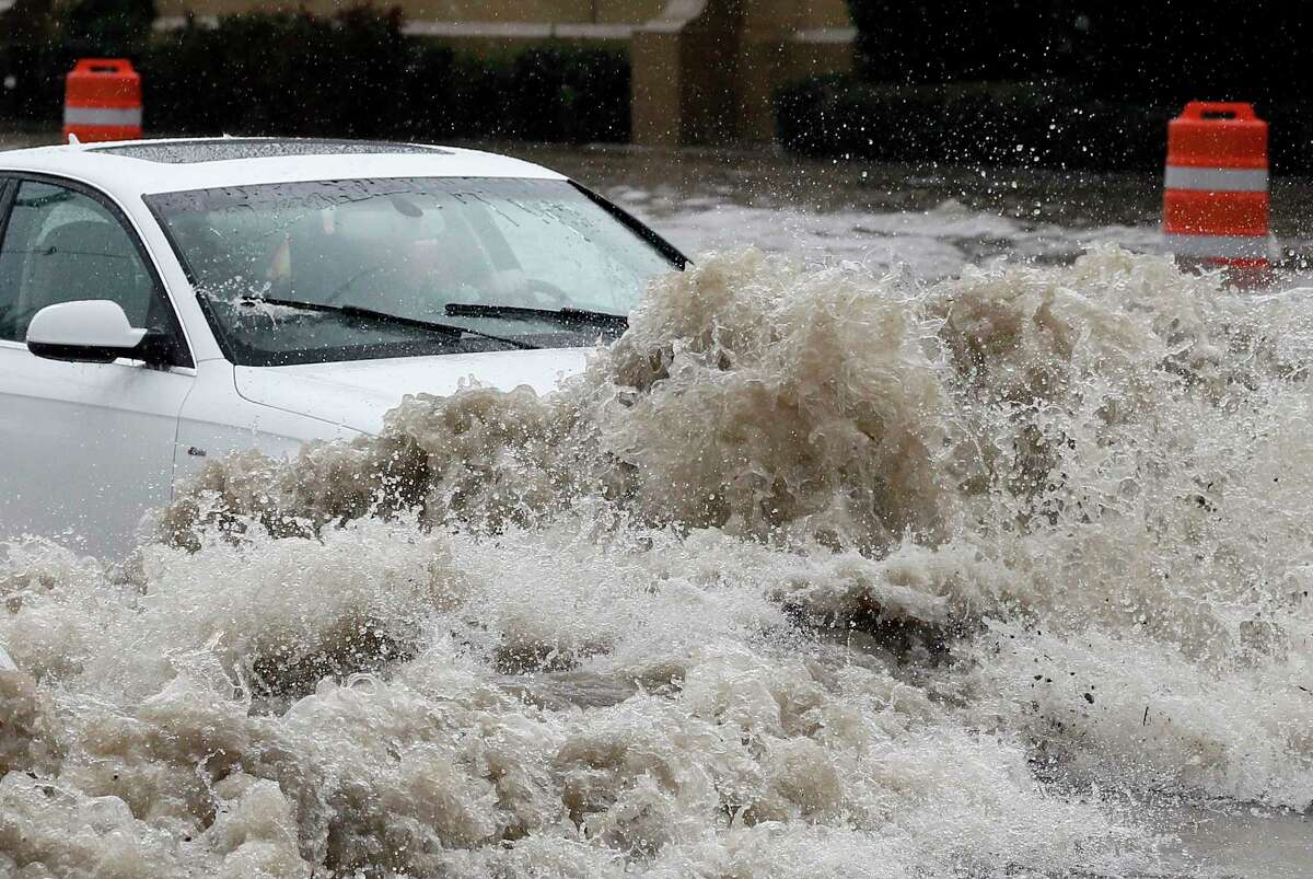 AP Photo/Tony Gutierrez A driver attempts to navigate through high water on Northwest Highway during a heavy rain fall Friday, Oct. 23, 2015, in Dallas. The driver who was unharmed, abandoned the vehicle on the road when emergency responders arrived. Emergency management officials in Texas contending with multiple storm systems are preparing for heavy rains to continue through the weekend and widespread flooding that may follow.