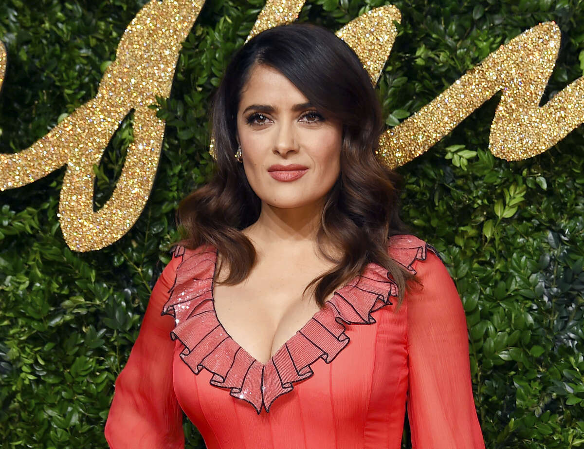 In this Nov. 23, 2015 photo, Salma Hayek poses for photographers at the British Fashion Awards 2015 in London. Hayek will join other celebrities, including Samuel L. Jackson, Kenneth Cole, Jason Collins, America Ferrera, Quincy Jones as co-chairs of a two-day Rise Up as One convention on Oct. 14-15 to celebrate diversity and unity.