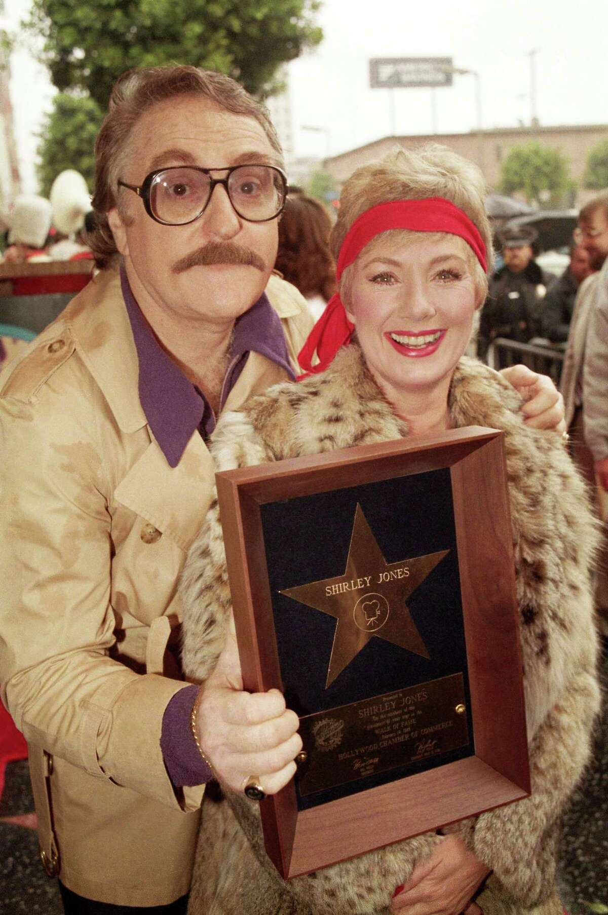 In this Feb. 14, 1986 file photo, actress Shirley Jones poses with her husband Marty Ingels with a plaque awarding her with a star on the Hollywood Walk of Fame in Los Angeles. Ingels, a comedian, actor and talent agent who was married to Jones for nearly 40 years, died Wednesday, Oct. 21, 2015, in Los Angeles following complications from a stroke. He was 79.