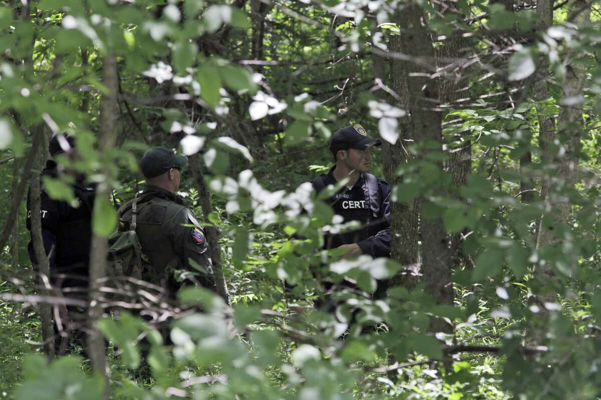 Authorities search an area in Constable, N.Y. for convicted murderers Richard Matt and David Sweat, Friday, June 26, 2015. Police shifted a focus of their three week search closer to the Canadian border.