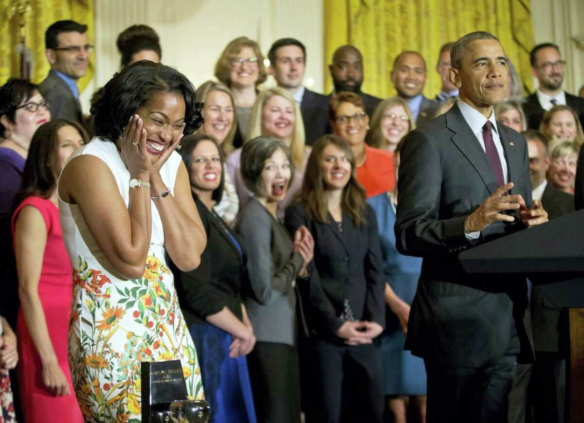 The 2016 National Teacher of the Year Jahana Hayes, left, reacts to being acknowledged by President Barack Obama, Tuesday, May 3, 2016, during a ceremony in the East Room of the White House in Washington.