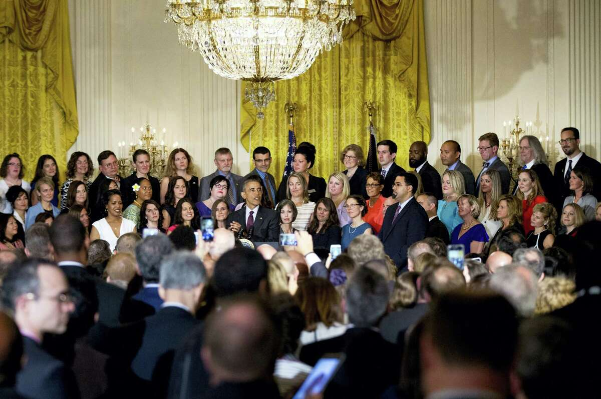 President Barack Obama with the 2016 National Teacher of the Year Jahana Hayes, and finalists speaks during a ceremony Tuesday, May 3, 2016, in the East Room of the White House in Washington. Hayes is a Social Studies teacher at John F. Kennedy High School in Waterbury.