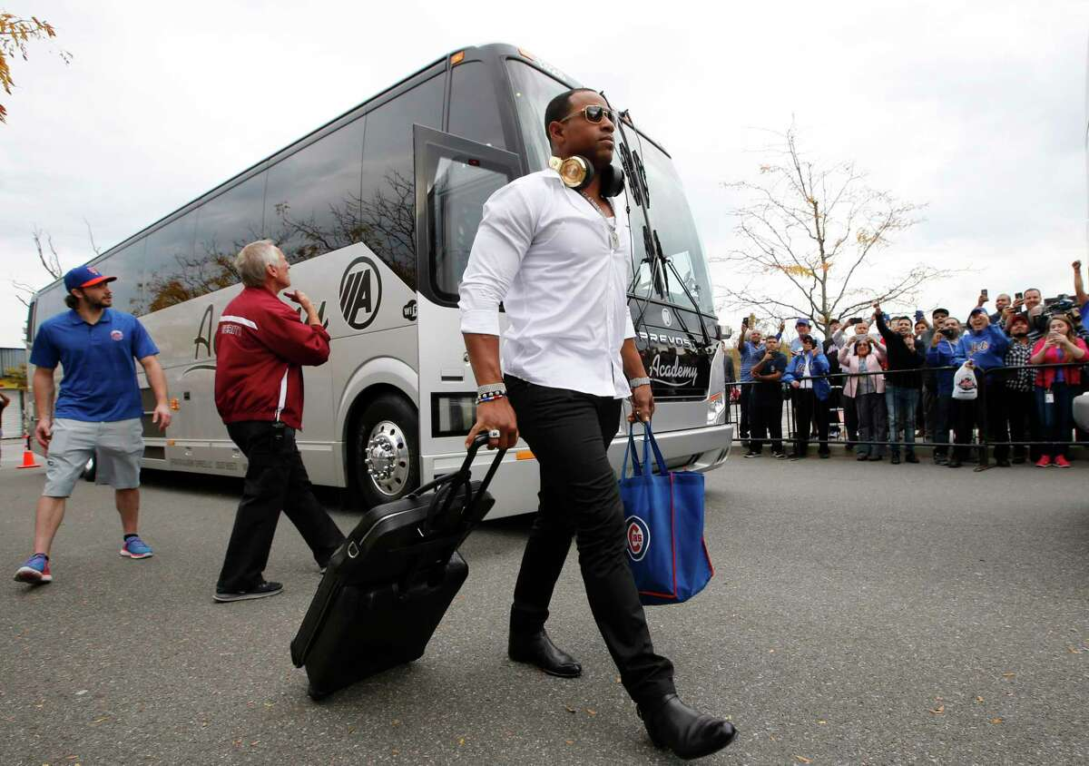 New York Mets outfielder Yoenis Cespedes walks with his luggage Thursday in New York.