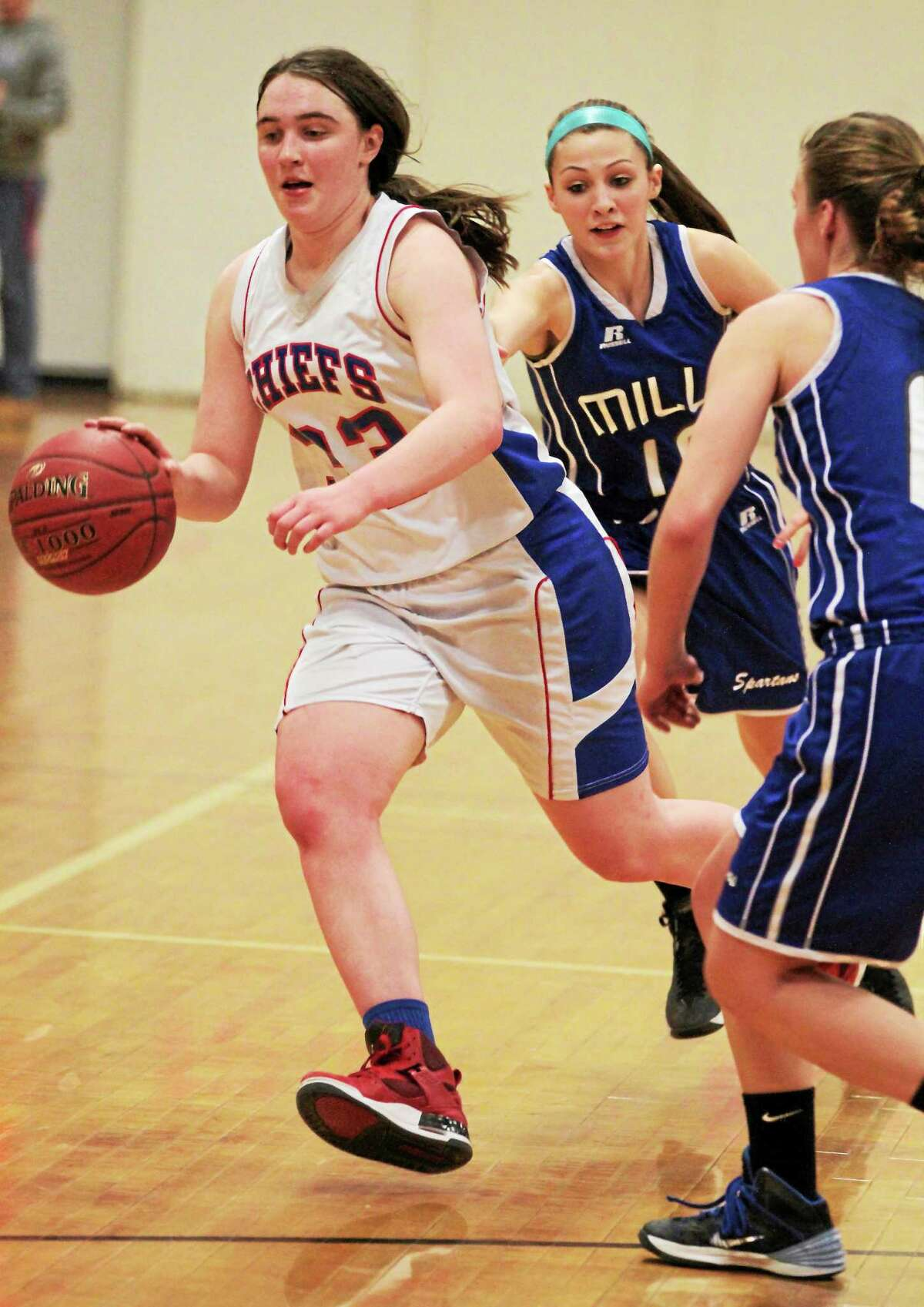 Jessica Fengler of Nonnewaug dribbles the ball in her team's win over Lewis Mills.
