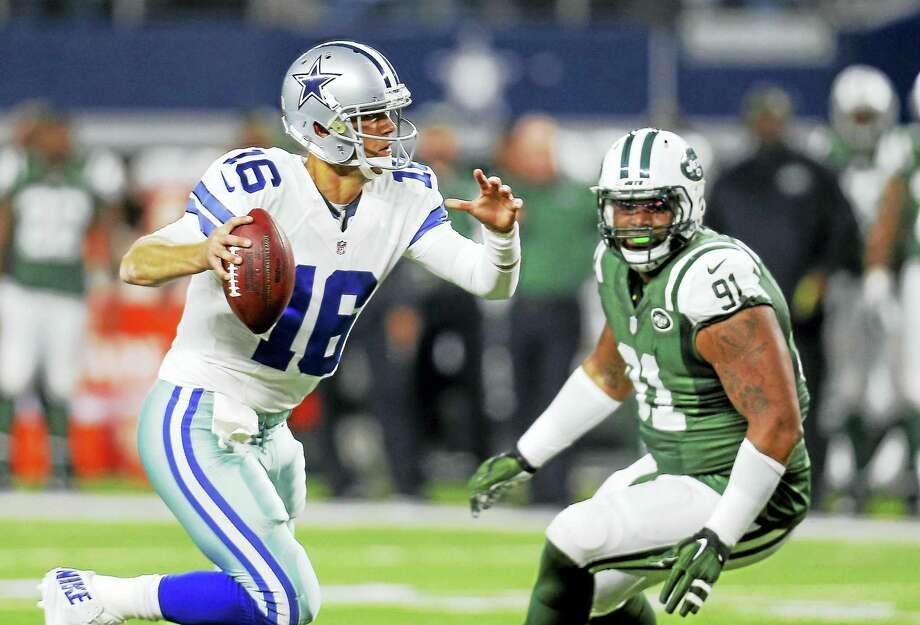 Sheldon Richardson, pressuring Cowboys quarterback Matt Cassel here last season, has proven he can help on the field. His off field problems could lead to a suspension, however. Photo: The Associated Press  / FR168019 AP