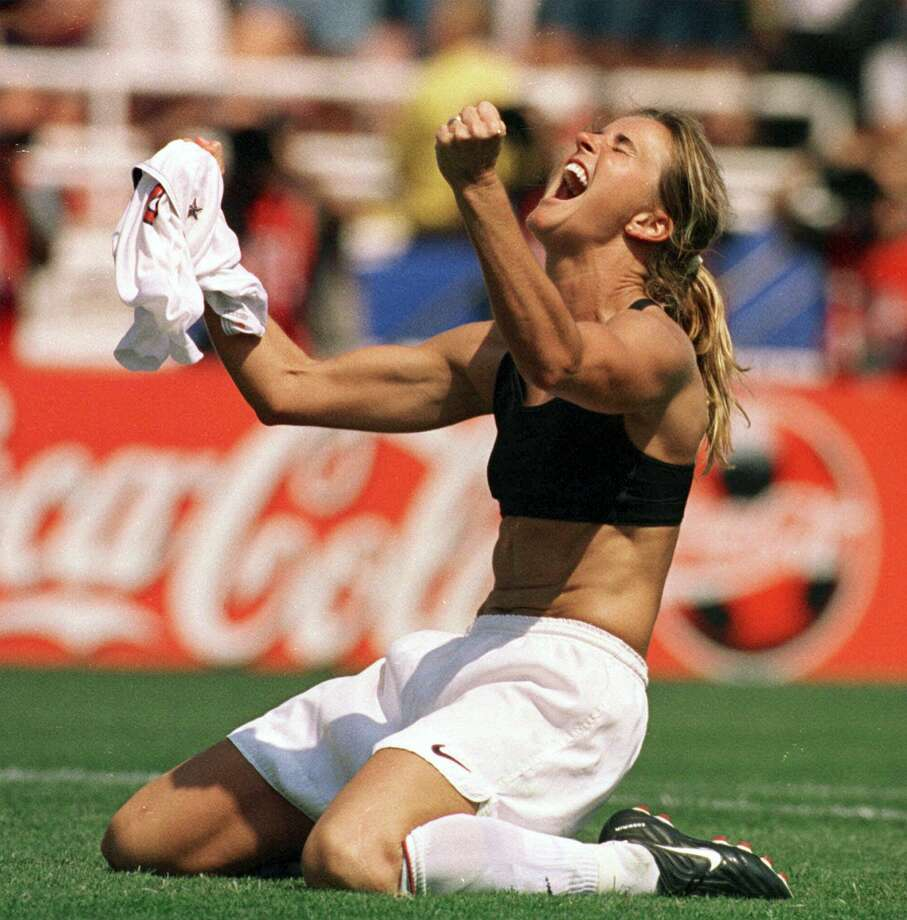 In this July 10, 1999 file photo, the United States' Brandi Chastain celebrates by taking off her jersey after kicking in the game-winning penalty shootout goal against China in the Women's World Cup final at the Rose Bowl in Pasadena, Calif. Photo: Lacy Atkins — The San Francisco Examiner File Photo  / The San Francisco Examiner