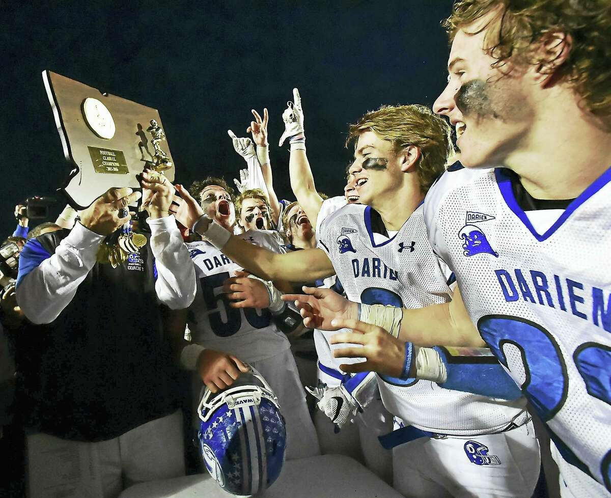The Darien Blue Wave celebrate after defeating the Shelton Gaels 39-7 for the Class LL state football championship back on December 12, 2015, at New Britain Stadium at Willowbrook Park in New Britain. Darienfinishred No. 1 last season and start the year atop the Register/GameTimeCT Top 10 poll again.