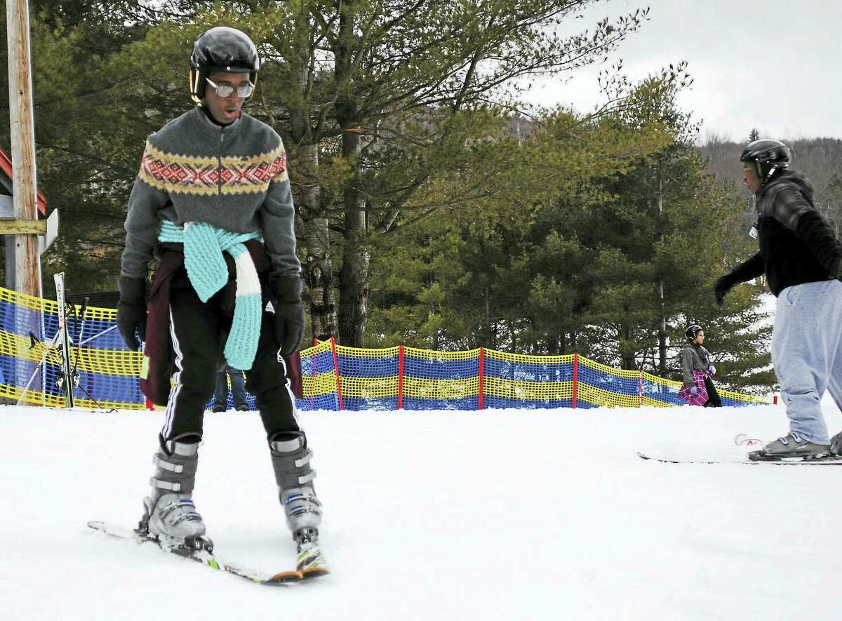 Shaemour Pinnock, a junior at the Academy of Engineering and Green Technology in Hartford, cautiously makes it downhill at Mohawk Mountain in Cornwall on Thursday.
