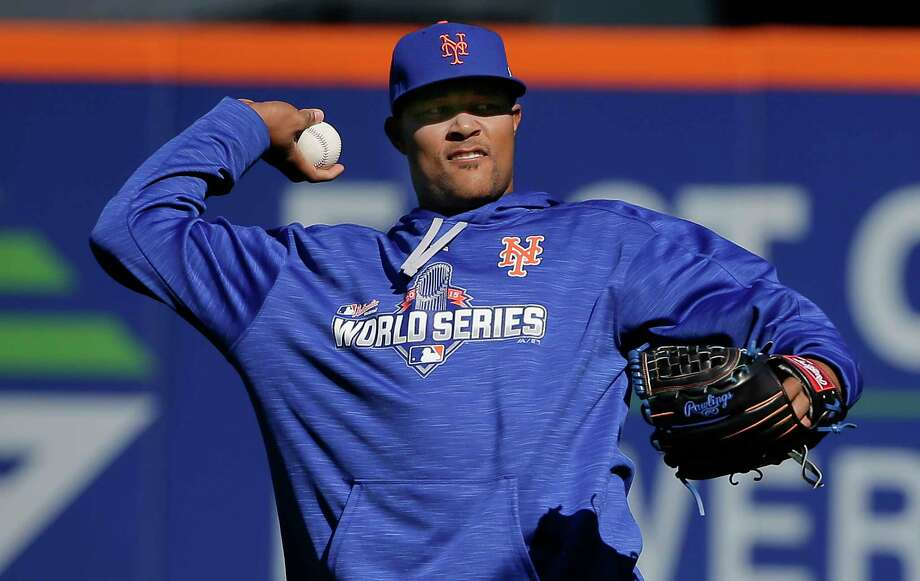 Mets closer Jeurys Familia throws in the outfield during a voluntary workout on Friday in New York. Photo: Julie Jacobson — The Associated Press  / AP