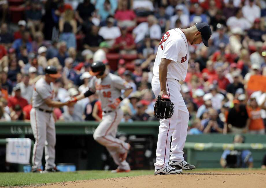 Red Sox starter Eduardo Rodriguez reacts after giving up a two-run home run to Baltimore Orioles catcher Matt Wieters on Thursday afternoon in Boston. Photo: Elise Amendola — The Associated Press  / AP