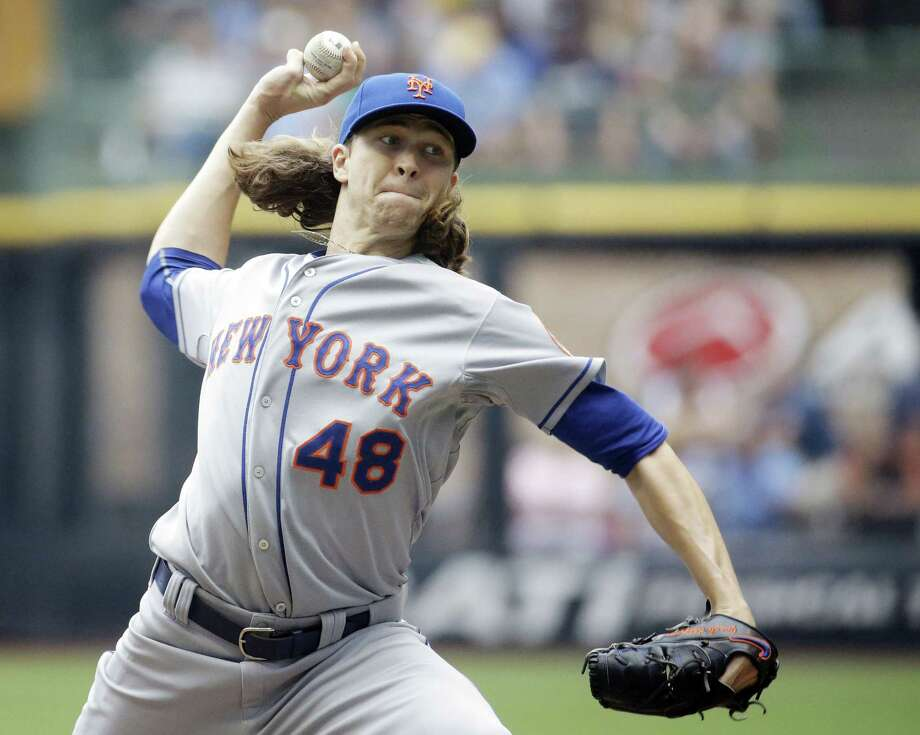 New York Mets starter Jacob deGrom throws during the first inning of Thursday's win over the Brewers in Milwaukee. Photo: Morry Gash — The Associated Press  / AP