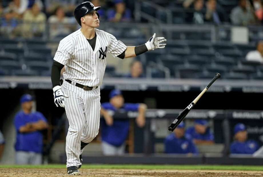 New York Yankees' Tyler Austin drop his bat and watches his two-run home run in the seventh inning against the Toronto Blue Jays on Tuesday. The Yankees hung on to beat the Jays 7-6. Photo: ADAM HUNGER — THE ASSOCIATED PRESS  / FR110666 AP