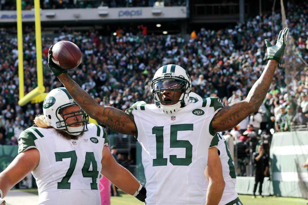 New York Jets wide receiver Brandon Marshall (15) celebrates with teammates Nick Mangold (74) and Eric Decker (87) after scoring on a touchdown pass from Ryan Fitzpatrick, not pictured, during Sunday's game.