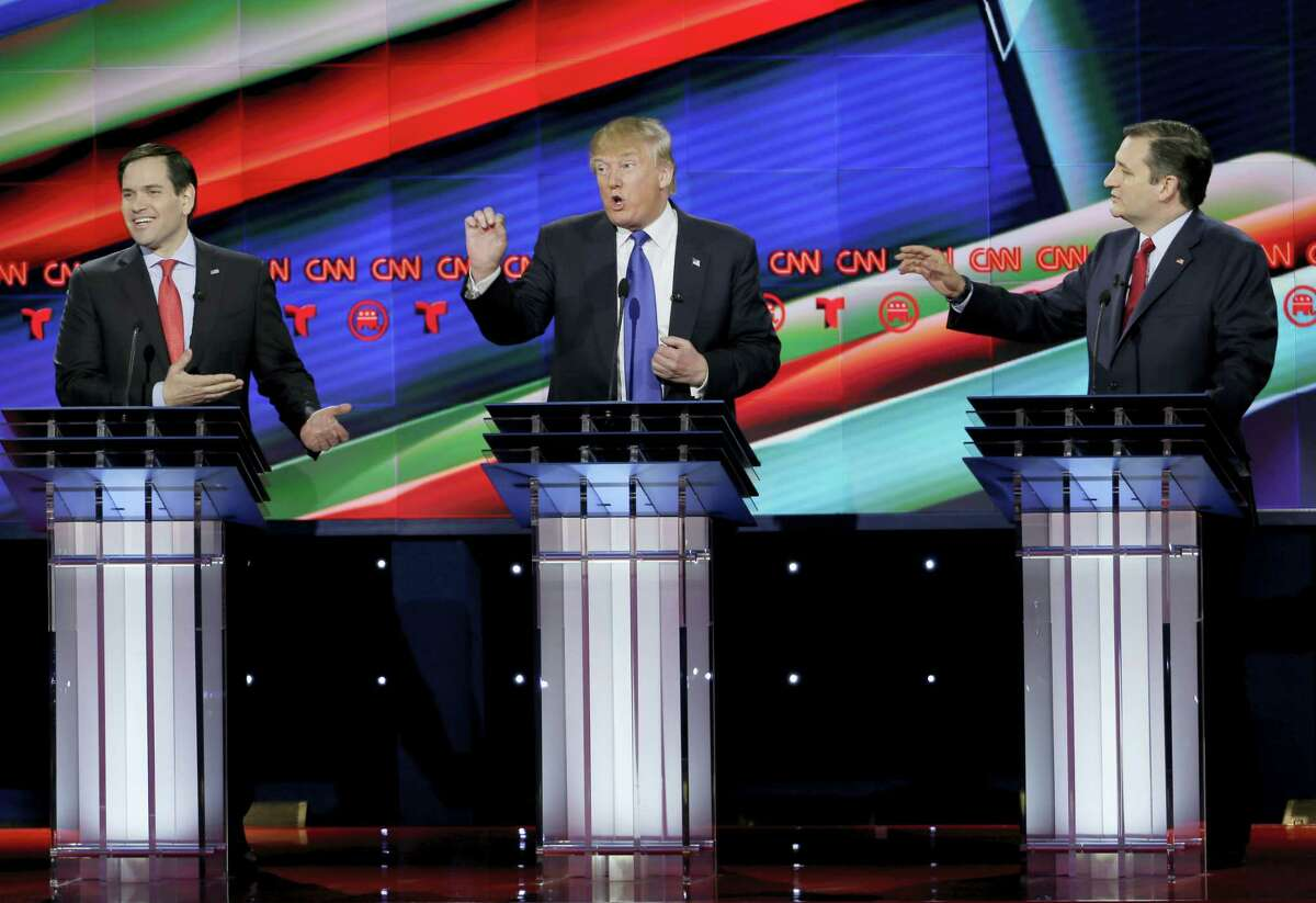 From left, Republican presidential candidate, Sen. Marco Rubio, R-Fla., Republican presidential candidate, businessman Donald Trump and Republican presidential candidate, Sen. Ted Cruz, R-Texas, speak and gesture during a Republican presidential primary debate at The University of Houston, Thursday, Feb. 25, 2016, in Houston.