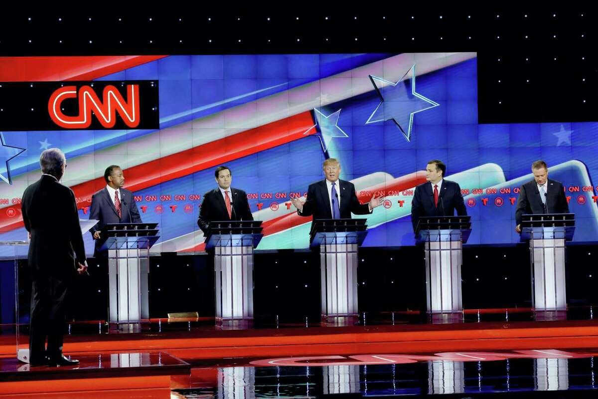 As Republican presidential candidate, businessman Donald Trump, center, speaks, Republican presidential candidates, retired neurosurgeon Ben Carson, left, Sen. Marco Rubio, R-Fla., second from left, Sen. Ted Cruz, R-Texas, second from right and Ohio Gov. John Kasich, right, look on during a Republican presidential primary debate at The University of Houston, Thursday, Feb. 25, 2016, in Houston.