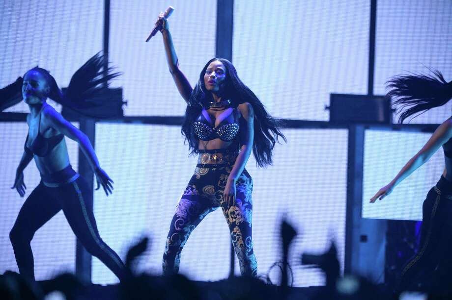 FILE - In this Sept. 19, 2014 file photo, Nicki Minaj performs at the iHeartRadio Music Festival in Las Vegas, Nev. Minaj says two members of her tour have been stabbed in Philadelphia, one of them fatally. Minaj wrote on Twitter Wednesday, Feb. 18, 2014, that the two had flown into Philadelphia for rehearsals two days ago. Philadelphia police say two men, ages 29 and 26, were stabbed early Wednesday outside a bar. They say the 29-year-old was killed and the younger man critically wounded. (Photo by Al Powers/Powers Imagery/Invision/AP, File) Photo: Powers Imagery/Invision/AP / Invision
