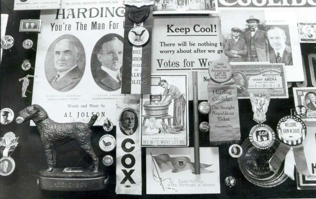 In this 1989 photo, a montage of memorabilia from past political campaigns past is laid out to dry in the rare book room of the University of Hartford's Museum of American Political Life in Hartford, Conn. J. Doyle DeWitt, president of The Travelers Insurance Company in the 1950's, donated thousands of items from his personal collection to the university.