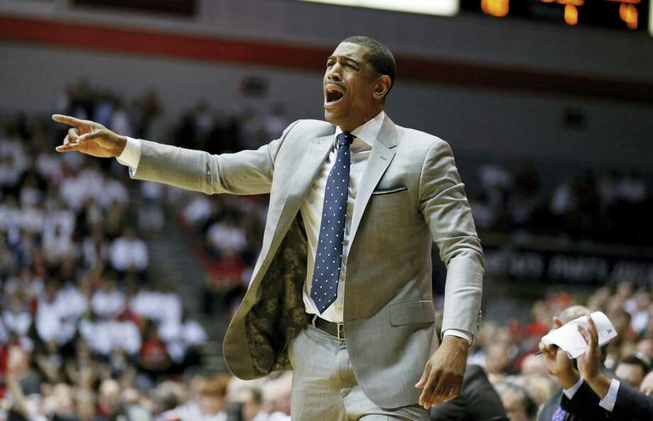 Connecticut head coach Kevin Ollie knows his team has had trouble at South Florida in the past, and can't afford to stumble at this point of the season. Photo: The Associated Press  / FR171284 AP