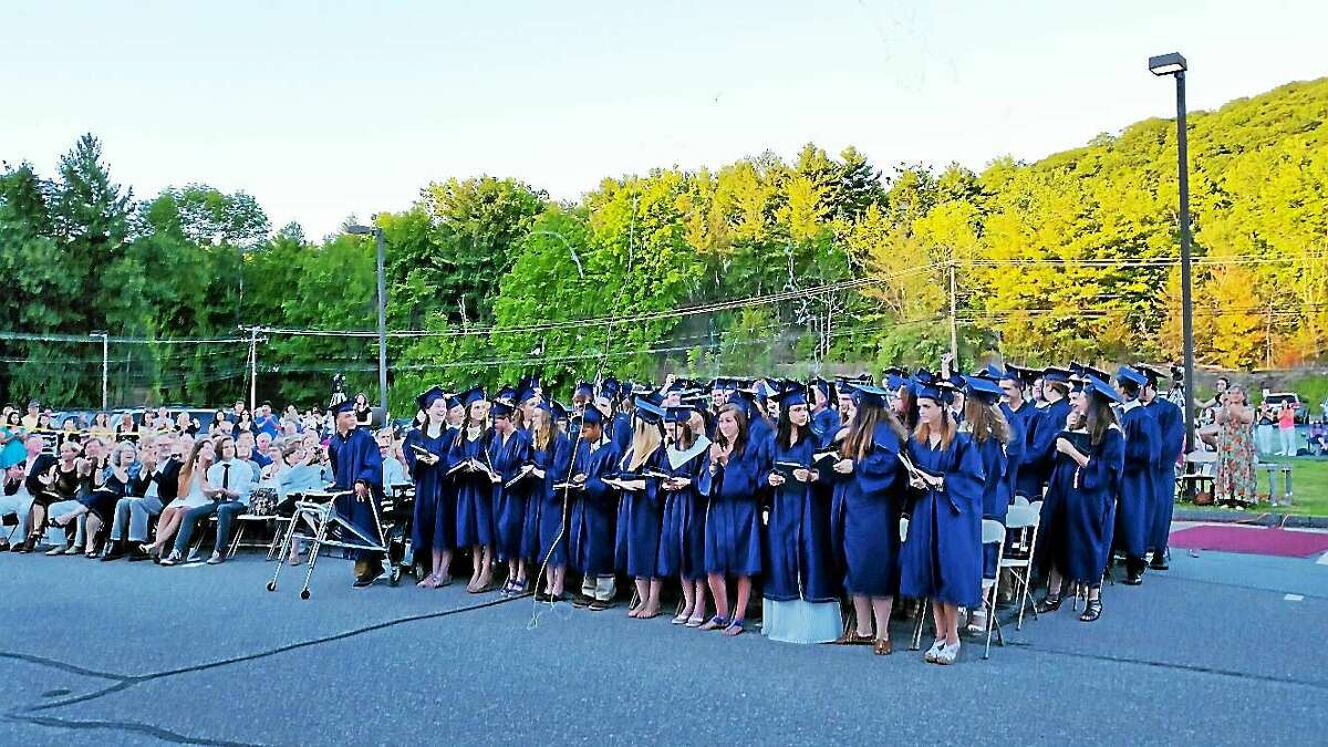 Eighty-eight students from Housatonic Valley Regional High School's Class of 2015 exited the ceremony after graduation in front of the school at 246 Warren Turnpike in Falls Village on Wednesday evening.
