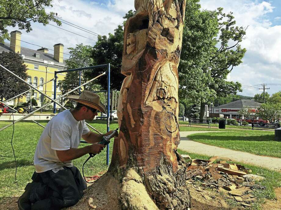 Ben Lambert - The Register Citizen  Jared Welcome of JareBear Carvings works Thursday in East End Park, carving animals out of the remains of a dead tree. Photo: Journal Register Co.