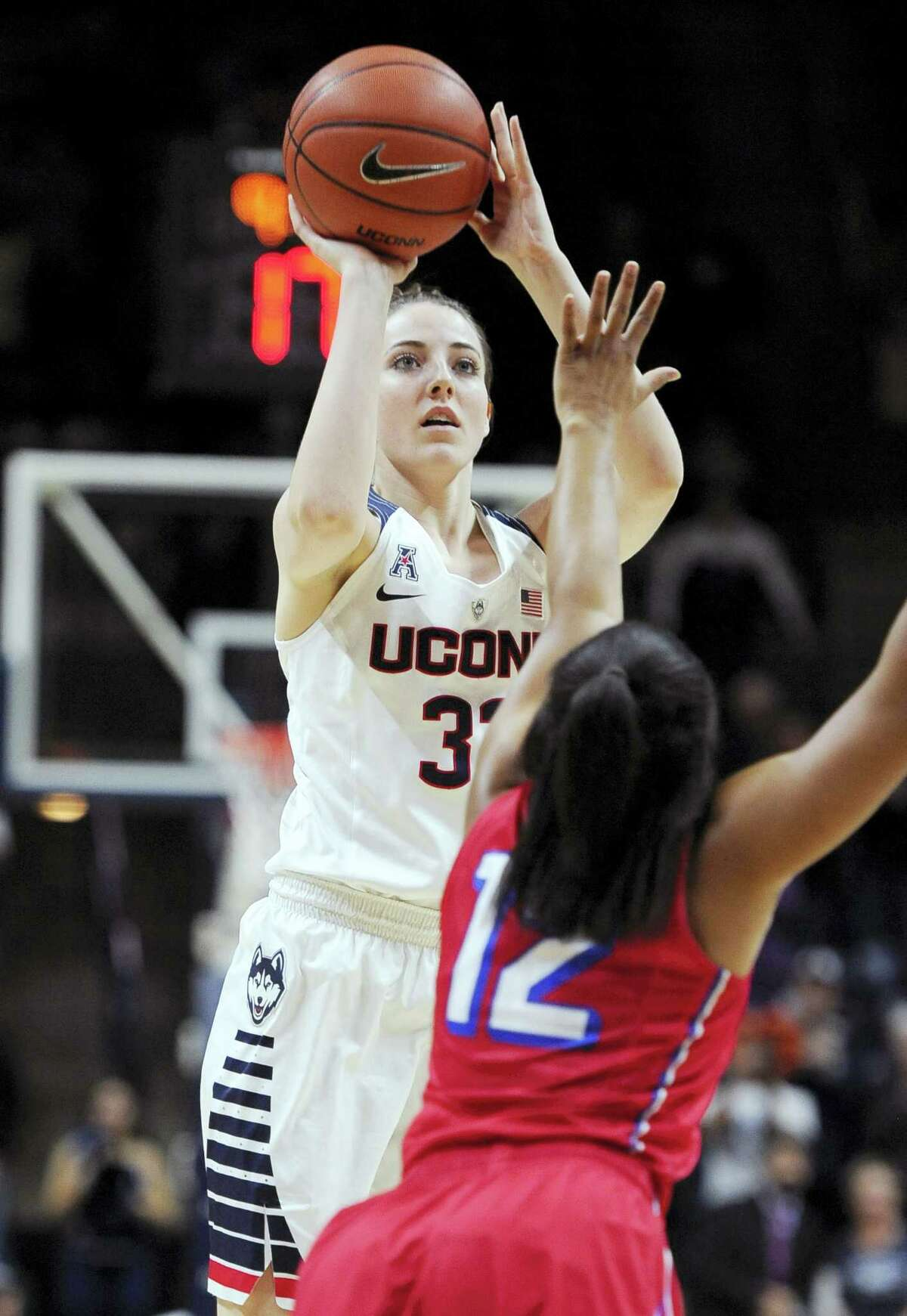 UConn freshman Katie Lou Samuelson shoots over SMU's Morgan Bolton during the first half Wednesday en route to tying her career high with 21 points.