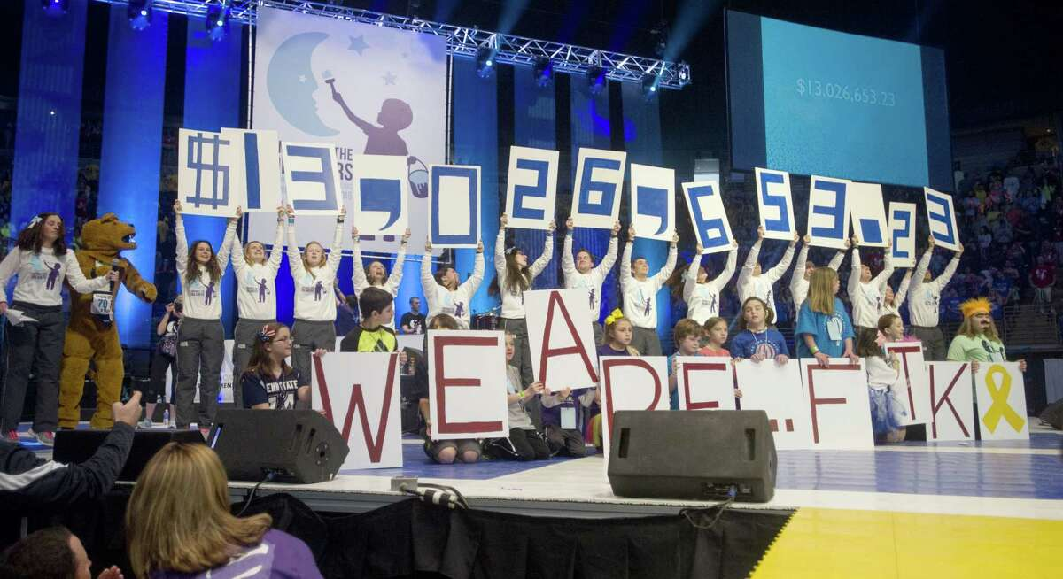 Penn State IFC/Panhellenic Dance Marathon executive committee announces the grand total raised $13,026,653.23 for the Four Diamonds Fund at the end of the 46 hour thon on Sunday, Feb. 22, 2015 in the Bryce Jordan Center in State College, Pa. (AP Photo/Centre Daily Times, Abby Drey)