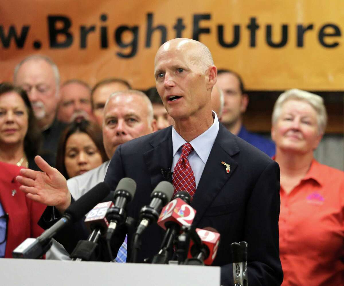 Florida Gov. Rick Scott delivers remarks on jobs growth during a visit to Bright Future Electric, an electrical contractor business with offices in Florida and Alabama, Thursday, June 11, 2015, in Ocoee, Fla. (Joe Burbank/Orlando Sentinel via AP)