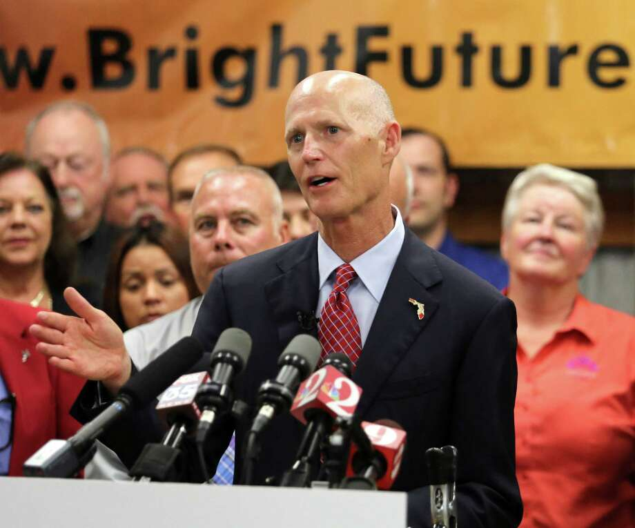 Florida Gov. Rick Scott delivers remarks on jobs growth during a visit to Bright Future Electric, an electrical contractor business with offices in Florida and Alabama,  Thursday, June 11, 2015, in Ocoee, Fla. (Joe Burbank/Orlando Sentinel via AP) Photo: AP / Orlando Sentinel