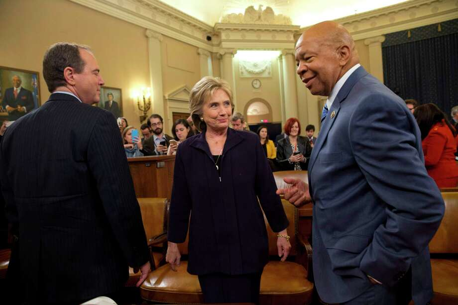 Democratic presidential candidate and former Secretary of State Hillary Rodham Clinton, center, is greeted by Rep. Adam Schiff, D-Calif., left, and Rep. Elijah Cummings, D-Md., the ranking member, right, after marathon testimony on Capitol Hill in Washington, Thursday, Oct. 22, 2015, before the House Select Committee on Benghazi. Photo: AP Photo/Jacquelyn Martin   / AP