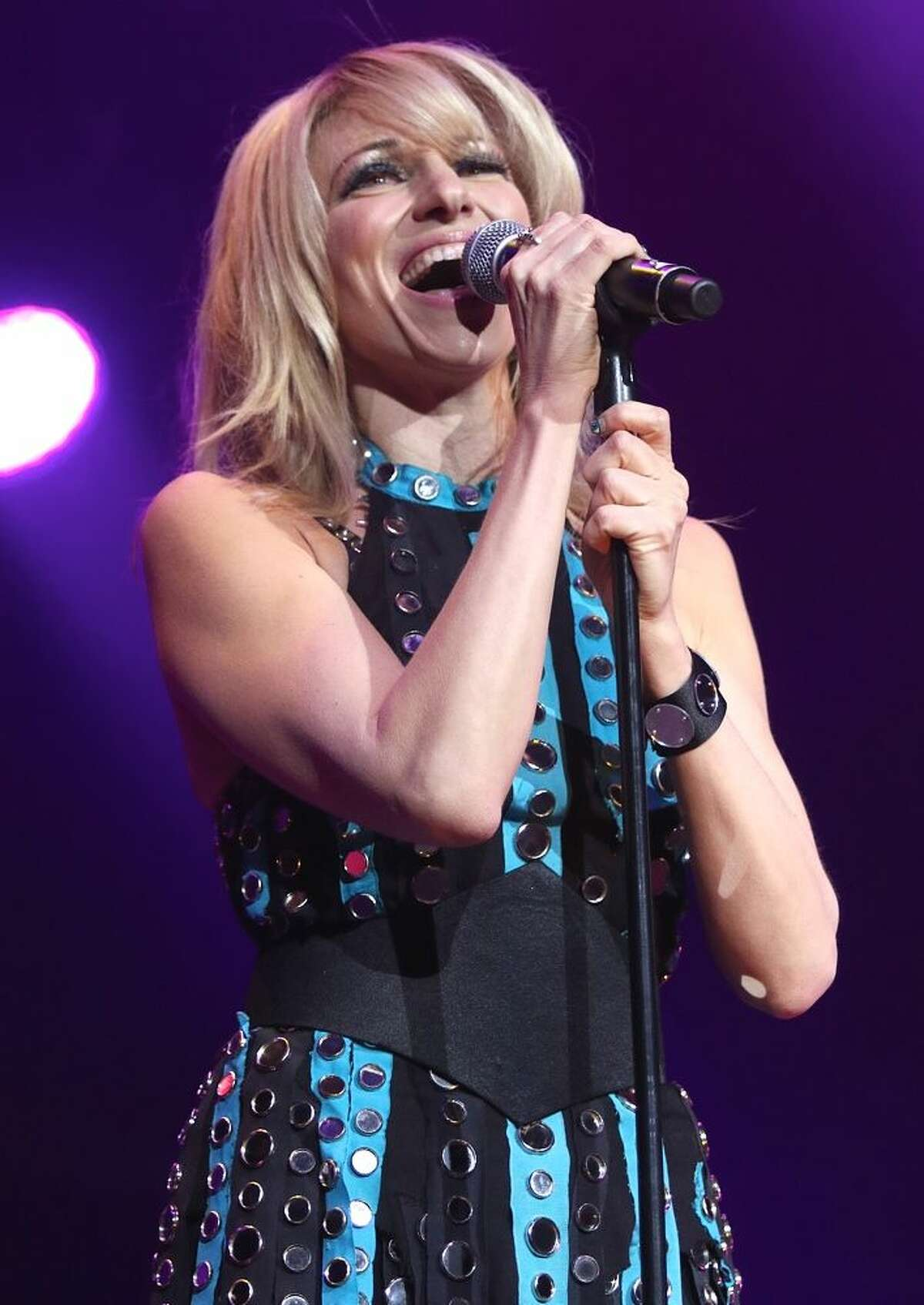 Photo by John Atashian Singer, songwriter, record producer, actress and former reality television competitor, Debbie Gibson, is shown performing at the Mohegan Sun Arena during her appearance Feb. 6. Debbieís set was part of the ì80ís Extravaganzaî concert, which also included performances by singers The Pointer Sisters, Terri Nunn & Berlin, Tiffany, Shannon, Club Nouveau and Andy Bell of Erasure.