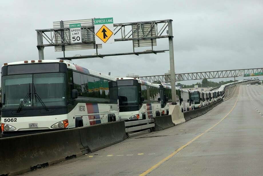 Metro buses line the HOV lane on Interstate 69 near Kashmere as a precaution in case of flooding in the bus barn close on Aug. 26, 2017. The decision likely saved the 120 buses from damage. Photo: Elizabeth Conley, Houston Chronicle / © 2017 Houston Chronicle