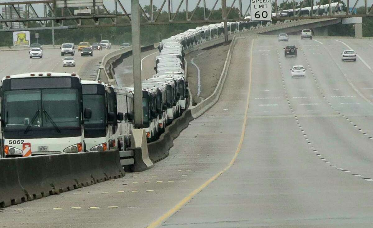Metro buses line the HOT lane on Interstate 69 as a precaution in case of flooding at the Kashmere bus facility on Aug. 26.