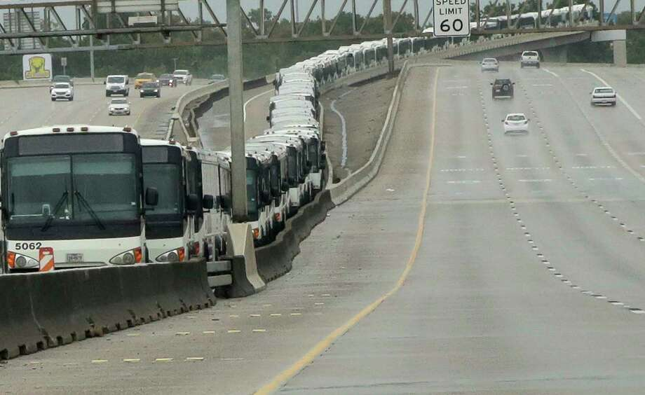 Metro buses line the HOT lane on Interstate 69 as a precaution in case of flooding at the Kashmere bus facility on Aug. 26. Photo: Elizabeth Conley, Houston Chronicle / © 2017 Houston Chronicle
