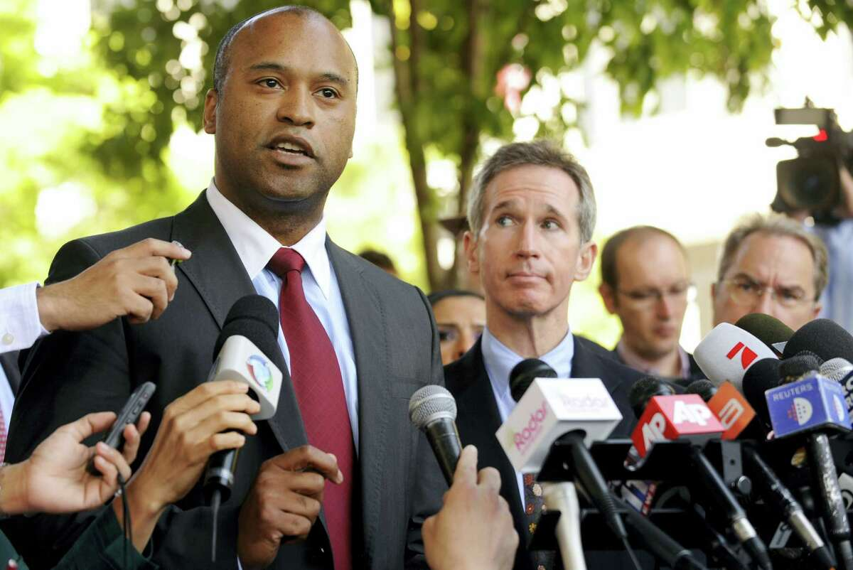 This July 6, 2009 photo shows Jackson family attorneys L. Londell McMillan, left, and Burt Levitch speaking to the media during a news conference outside the Superior Court in Los Angeles. Prince's longtime lawyer L. Londell McMillan says the death of the superstar was a complete shock.