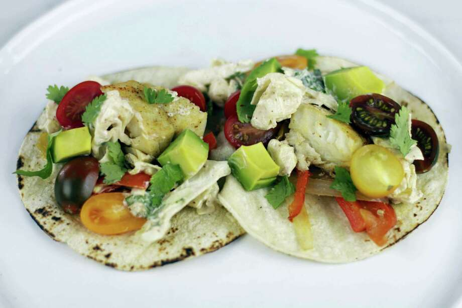 Foil-pack fish tacos are a great meal idea for the summer-to-fall transition. Photo: Melissa D'Arabian — The Associated Press  / Melissa d'Arabian