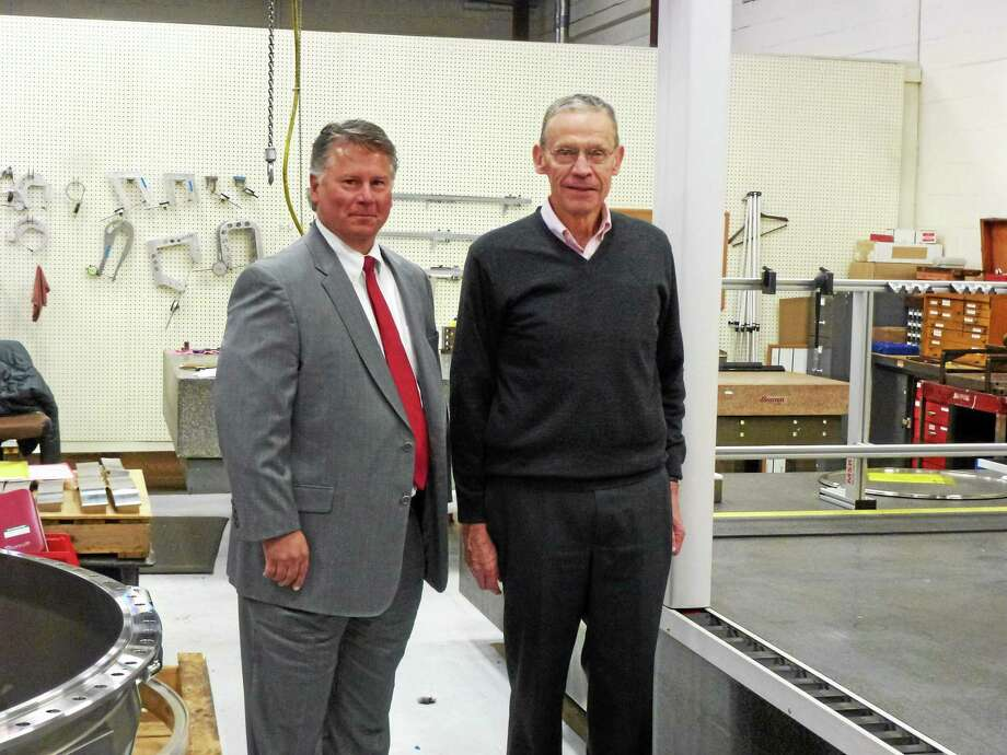 Air Industries Group CEO Daniel Godin, left, and Sterling Engineering President John Lavieri in the machine shop this week. Photo: Ryan Flynn — Register Citizen