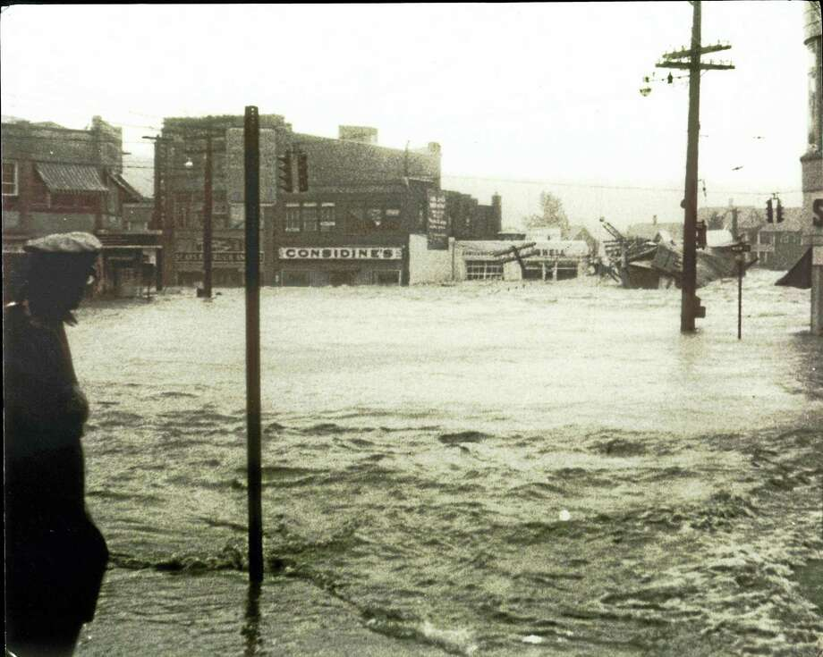 Contributed photoBlack Friday: The Flood of 1955, is on display at UConn Torrington through March 31. Photo: Journal Register Co.