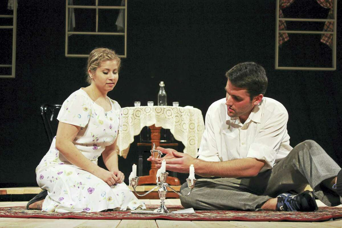 Contributed photoNicole Thomas as Laura and Matthew Albert as Tom in a scene from The Glass Menagerie at the Thomaston Opera House.