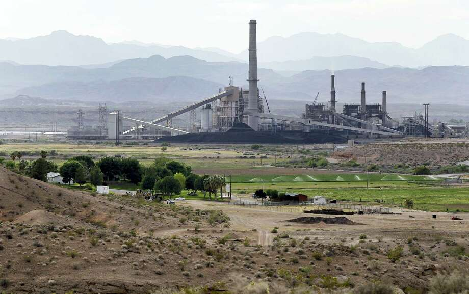 AP Photo/Julie Jacobson, File In this May 14, 2012 photo, the Reid-Gardner power generating station is seen near a farm on the Moapa Indian Reservation in Moapa, Nev. America has quietly but significantly shifted how and where it gets its energy during Barack Obama's presidency, slicing the nation's pollution of gases that are warming Earth. But experts say it is nowhere near enough and the president deserves only partial credit for an energy revolution. Photo: AP / Copyright 2016 The Associated Press. All rights reserved. This material may not be published, broadcast, rewritten or redistribu