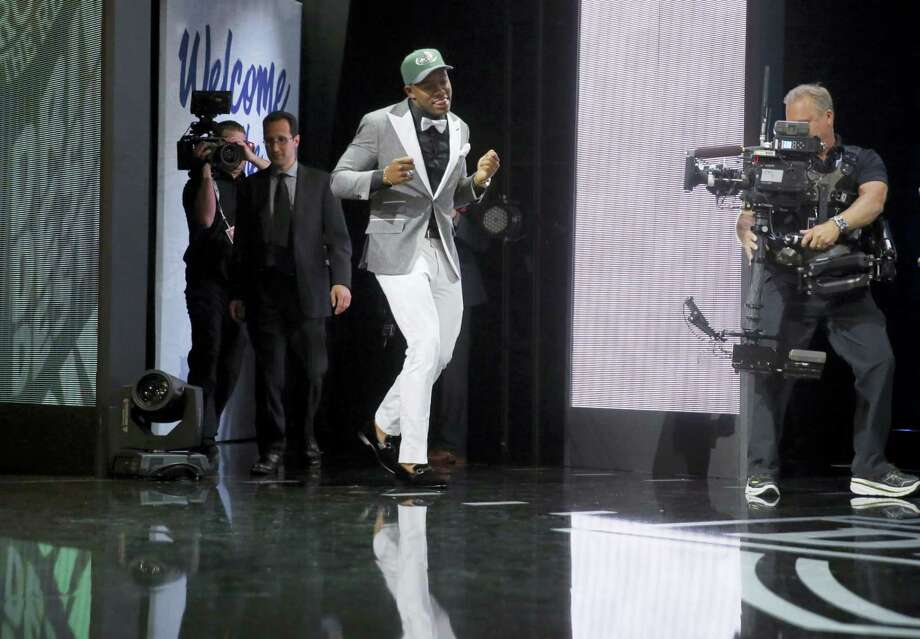 Ohio State's Darron Lee dances as he walks on the stage after being selected by the New York Jets as the 20th pick in the first round of the NFL draft on Thursday. Photo: The Associated Press  / AP