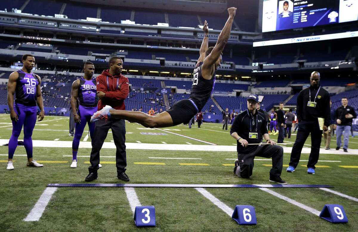 UConn defensive back Byron Jones broke the NFL combine record in the broad jump by eight inches on Monday with a leap of 12 feet, 3 inches.