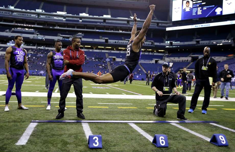 UConn defensive back Byron Jones broke the NFL combine record in the broad jump by eight inches on Monday with a leap of 12 feet, 3 inches. Photo: Julio Cortez — The Associated Press  / AP