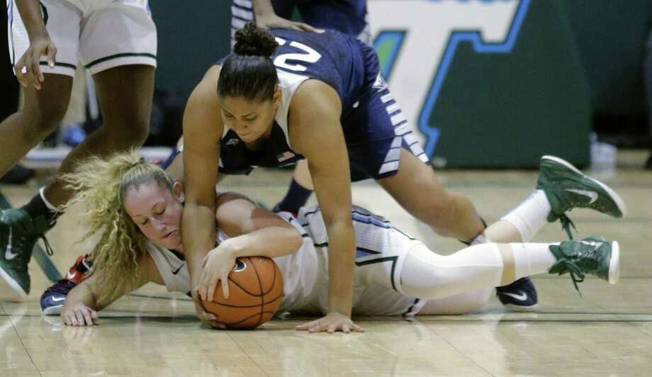 UConn's Kaleena Mosqueda-Lewis reaches over Tulane guard Jamie Kaplan in the first half Monday. Photo: The Associated Press  / FR170136 AP