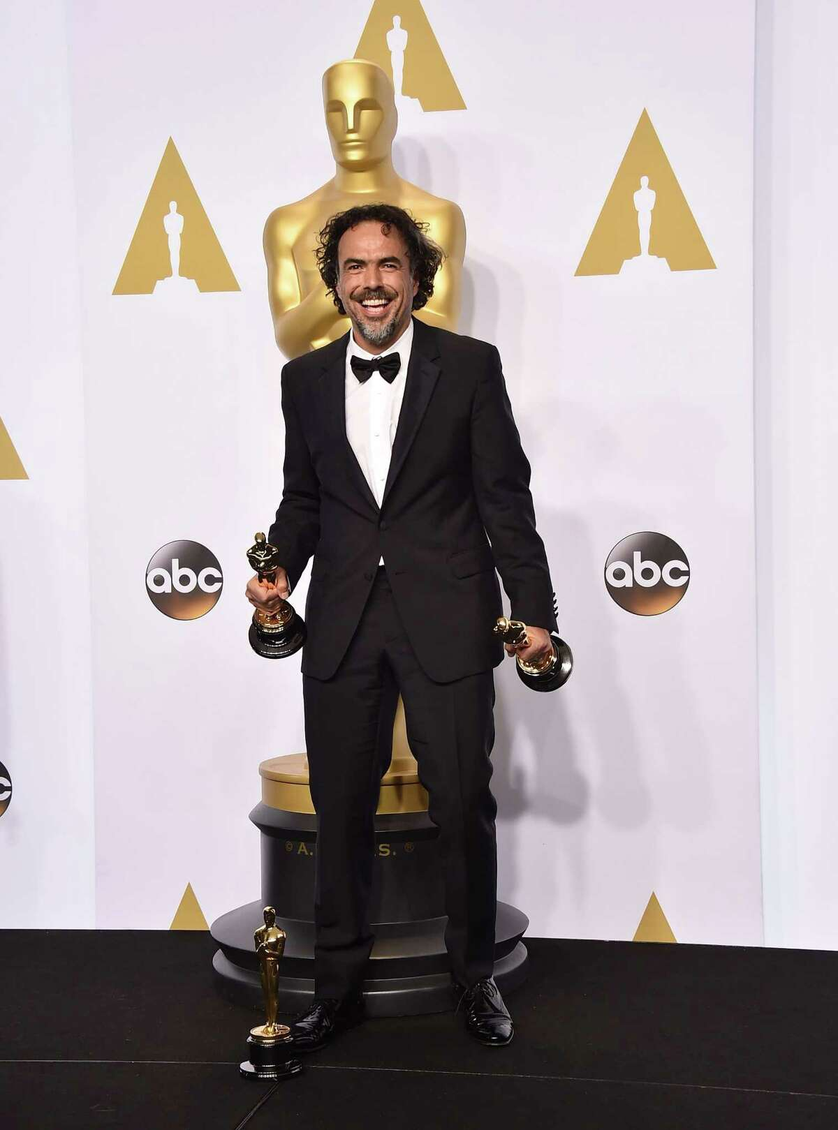 """Alejandro Gonzalez Inarritu poses in the press room with the award for best picture for ìBirdman"""" at the Oscars on Sunday, Feb. 22, 2015, at the Dolby Theatre in Los Angeles."""