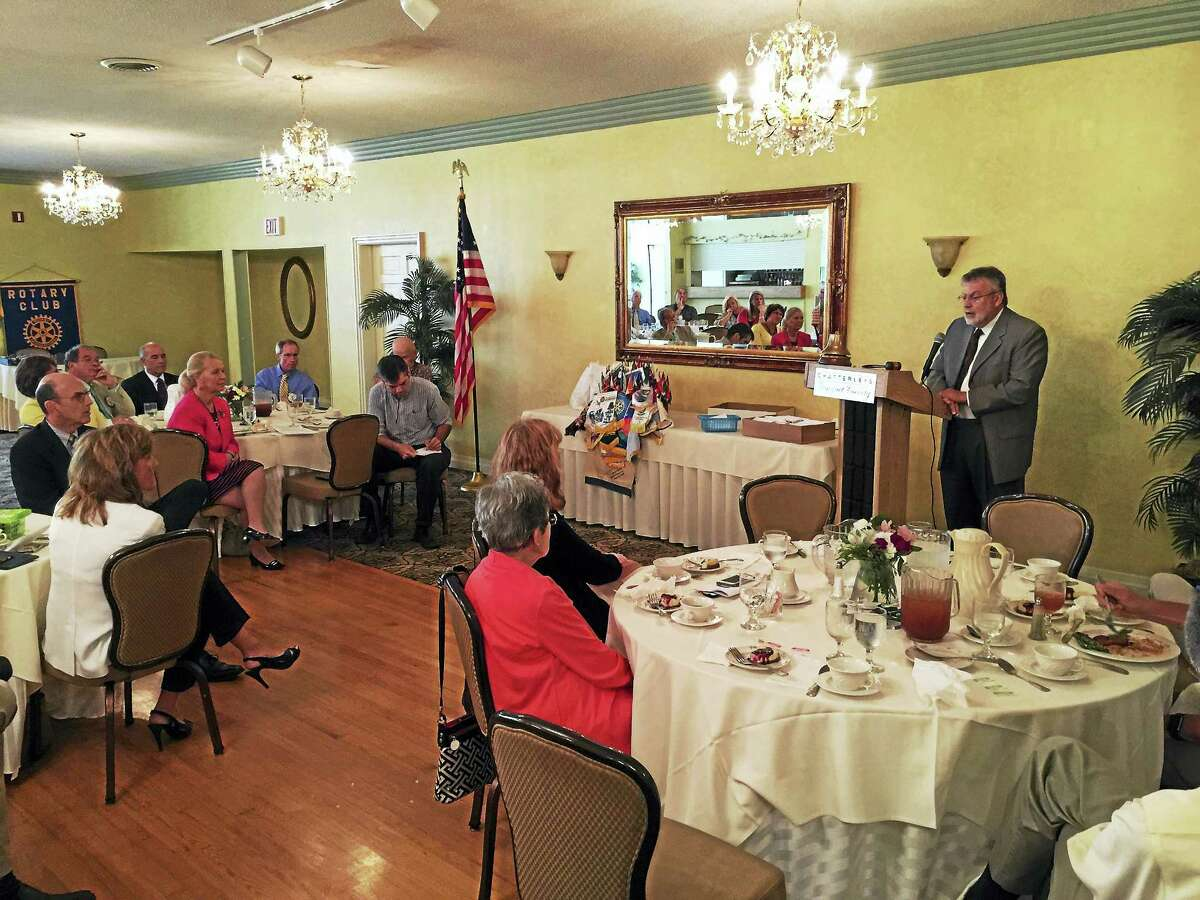 Ben Lambert - The Register Citizen Michael Marine addresses members of the Torrington-Winsted Area Rotary Club Tuesday in the Chatterley's Banquet Facility.