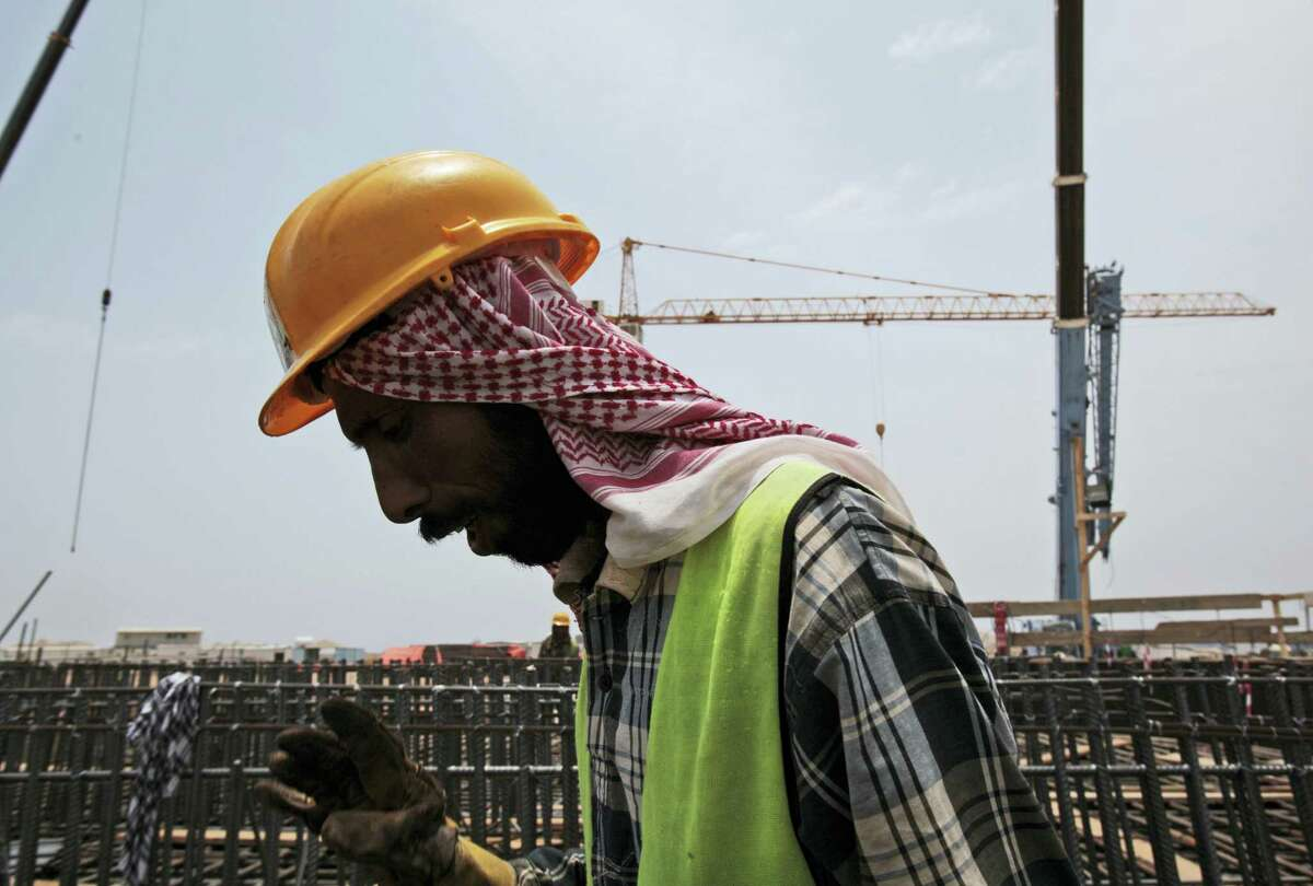 In this May 8, 2014 photo a man works on construction of the Kingdom Tower, a planned 252-story building, which aims to become the world's tallest skyscraper when complete, in Jiddah, Saudi Arabia.