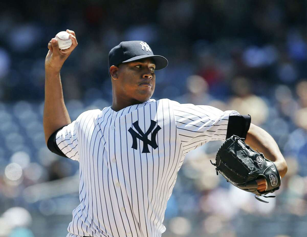 New York Yankees starter Ivan Nova, making his first major league start in 14 months, delivers in the first inning of Wednesday's win over the Philadelphia Phillies at Yankee Stadium.