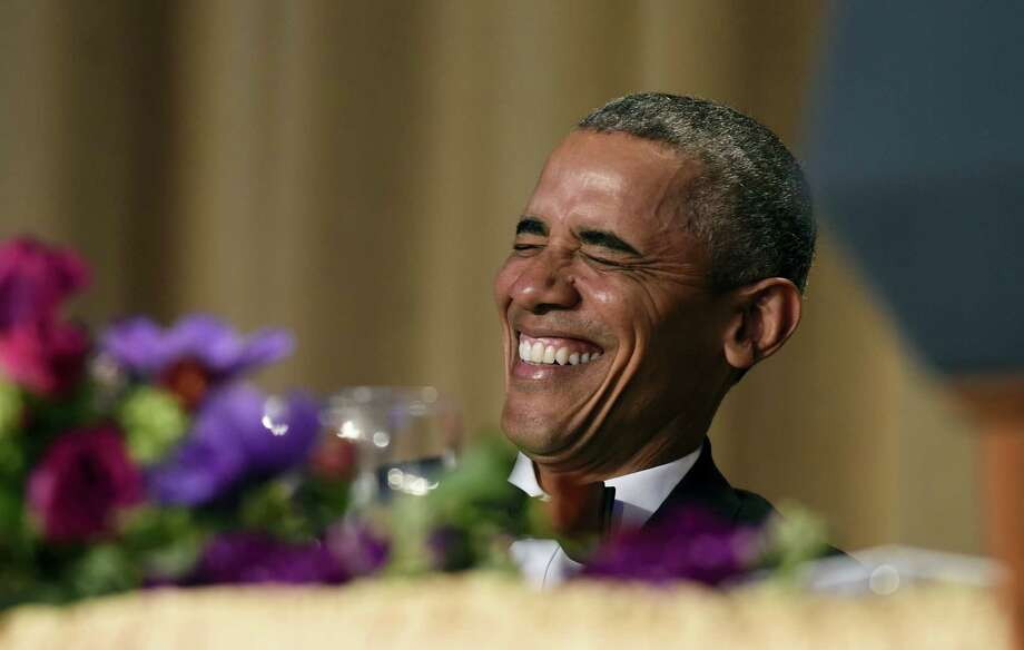 President Barack Obama laughs as he listens to Larry Wilmore, the guest host from Comedy Central, speak at the annual White House Correspondents' Association dinner at the Washington Hilton in Washington, Saturday, April 30, 2016. Photo: AP Photo/Susan Walsh  / Copyright 2016 The Associated Press. All rights reserved. This material may not be published, broadcast, rewritten or redistribu